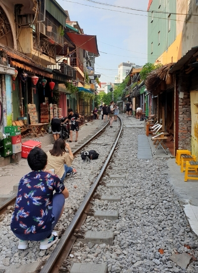 Tourists taking picture on tracks of Train Street Hanoi